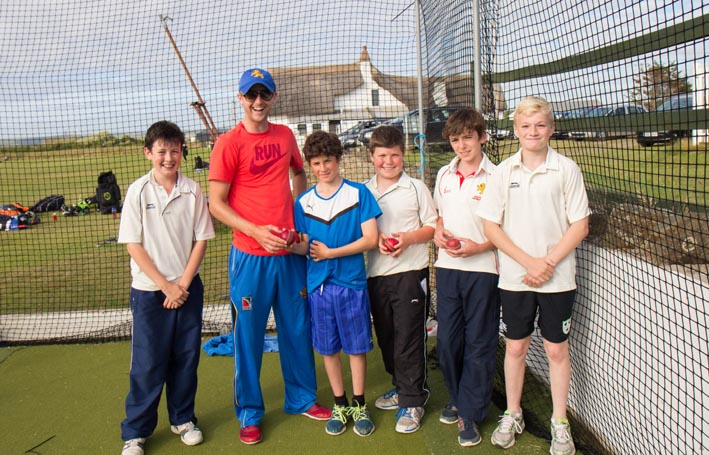 Coach Tom Allin (second from left) with youngsters in the nets at Instow