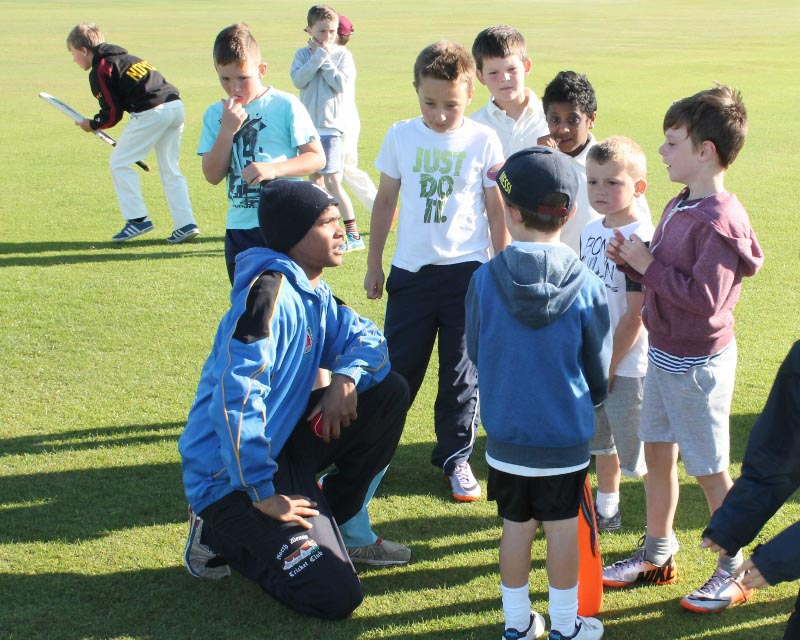 Player-coach Quintin Dreyer runs through fielding drills with North Devon CC youngsters