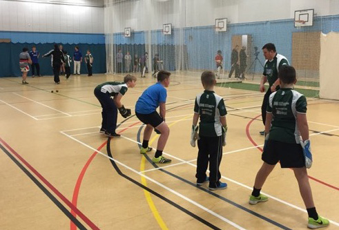Coach Craig Greenwood working with youngsters in Shaldon's nets