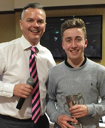 Bovey Tracey's Chris Yabsley, receiving a club award from Jeremy Christophers, He is one of the young players at Bovey to benefit from DSCT-supported coaching